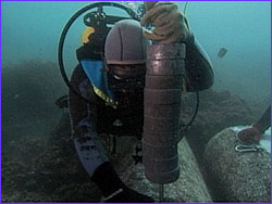 Diver attaching lead line to corner of block