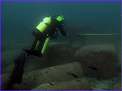 Diver mapping underwater feature