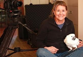 Filmmaker Allison Argo with a cockatoo