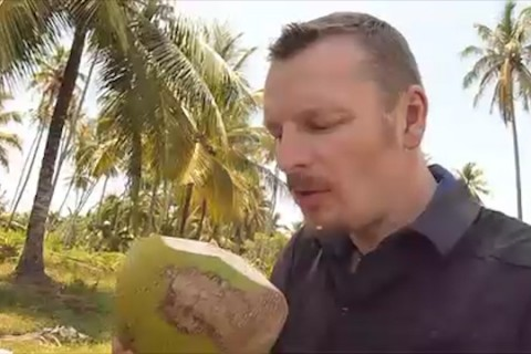 Drinking Coconut Milk Before a Long Jungle Boat Ride