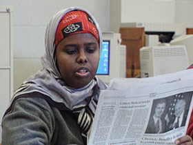 somalis-maine-post01-reading