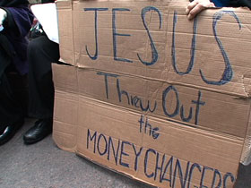 """A protester holds a sign at the Occupy Wall Street protests in New York City: """"Jesus Threw Out the Moneychangers"""""""
