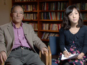 Pastor Phillip Buck with his daughter and interpreter Grace Yoon Yi
