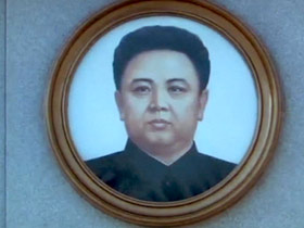 "A portrait of the now deceased Kim Jong Il — the former ""Dear Leader"" of North Korea"