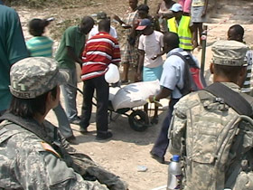 US military personnel overseeing food aid distribution