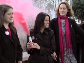 Members of Women's Ordination Conference release pink smoke to protest lack of female leadership in Catholic Church
