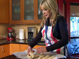 Diane Faith Lille prepares challah bread for the Jewish Sabbath dinner