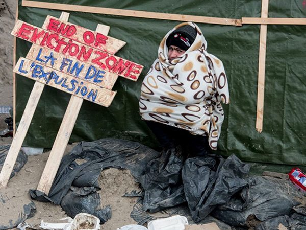 Migrants camped on streets in Paris cleared out by police